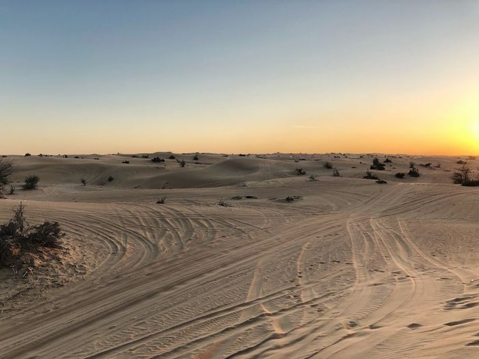 Landscape Nature Arid Climate Beauty In Nature Tranquil Scene Sand Outdoors Clear Sky Desert No People Tranquility Tire Track Scenics Sunset Sand Dune Day Sky Rethink Things Connected By Travel Be. Ready. EyeEmNewHere Perspectives On Nature Tranquility Postcode Postcards Beauty In Nature