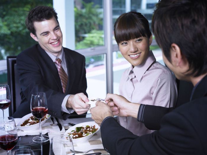 Colleagues At Restaurant During Meeting