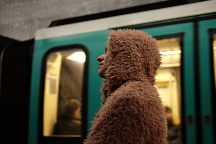 Low Angle View Of Woman In Fur Coat At Railroad Station