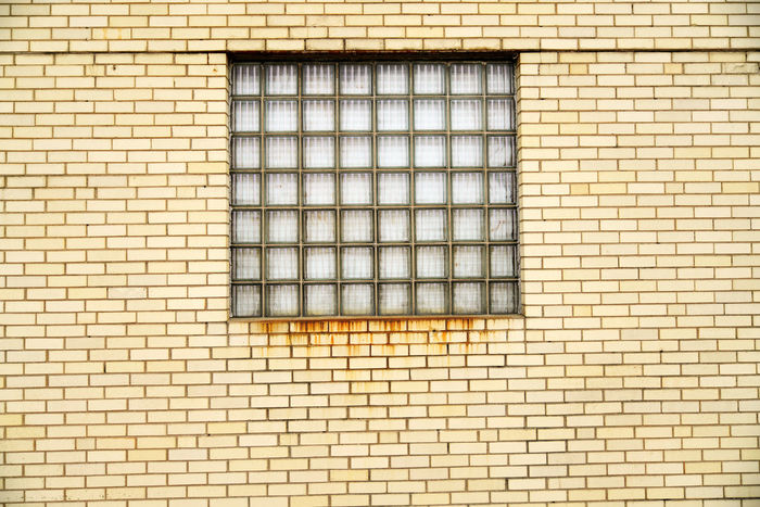 Brick Wall Geometric Shapes Square Windows Architecture Backgrounds Building Building Exterior Built Structure Day Full Frame Geometric Shape Glass - Material Grid In A Row No People Outdoors Pattern Repetition Shape Tile Wall Wall - Building Feature Window Yellow Wall EyeEmNewHere The Architect - 2018 EyeEm Awards