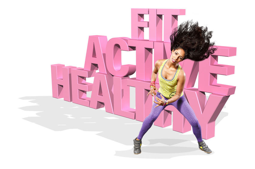 young woman at fitness exercise or zumba dancing Activity, Adult, Aerobics, Body, Build, Building, Dance, Exercises, Exercising, Fit, Fitness, Gym, Health, Healthy, Leisure, Lifestyles, Muscular, Shape, Sports, Strength, Training, Women, Young, Zumba Dancing Day Full Length One Person People Pink Color Portrait Studio Shot Text White Background Women Young Adult Young Women