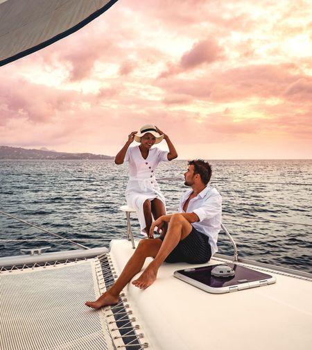 Boat Sailing Ship Sunset Sailing Ship Catamaran St Lucia Saint Lucia Dress Hat Woman Caribbean Man Water Friendship Young Women Sea Full Length Men Togetherness Bonding Sunset Beach Sun Hat Horizon Over Water Boyfriend Falling In Love Ocean Seascape Shore Wave