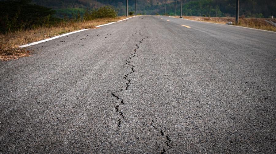Serface level of asphalt road with crack