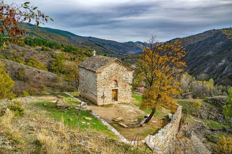 Church of mother of God, on top of the rock in Vrazji Kamen. Vrazji kamen (devil's rock) on south-eastern Serbia , near borders with Bulgaria and Macedonia. This natural phenomenon are made by erosion of river Pcinja. But more interesting is local legends about this place. People said that devils had wanted to change course of the river and because of that during the night they were throwing big rocks in the river. But they didn't succeed. Then they found one big rock from place nearby and they wanted to move it in the river, but rock was heavy and when they came close to the river they heard sound of rosters so they left rock and got away. From this period rocks stands until today , some of them about 60 meters high. Architecture Architecture_collection Church EyeEm Best Shots EyeEm Nature Lover Nature Architecture Autumn Beauty In Nature Building Exterior Built Structure Cloud - Sky Day Eye4photography  History Mountain Mountain Range Nature No People Outdoors Scenics Sky Tranquility Tree Water