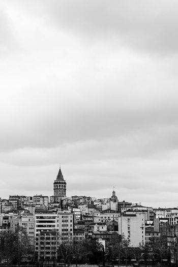 View of buildings and galata töre against cloudy sky