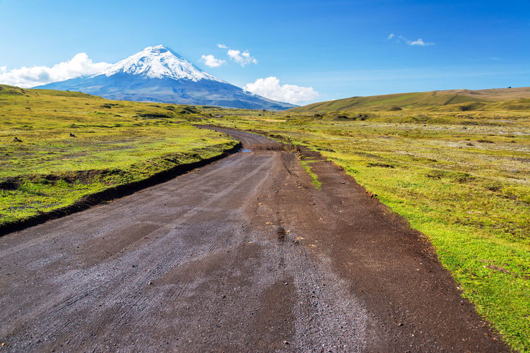 Country road leading to snowcapped mountain