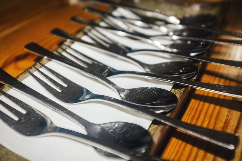 High angle view of silverware arranged on table