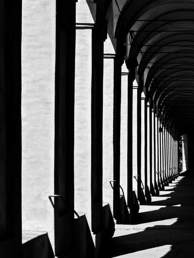 Arches in Bologna, Italy Ancient Arches Architectural Column Architecture Black And White Bologna Bologna, Italy Feel The Journey Column Contrasts Corridor Covered Portico Day Diminishing Perspective In A Row Italy Light And Shade Monastry No People Old Pórtico Religion Repetition Sanctuary Of The Madonna Of San Luca Stone