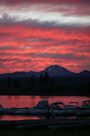Camping Lake Almanor. Pink Sky Beauty In Nature Cloud - Sky Day Moored Mountain Mountain Range Nature Nautical Vessel No People Orange Color Outdoors River Scenics Sky Sunset Tranquil Scene Tranquility Transportation Water