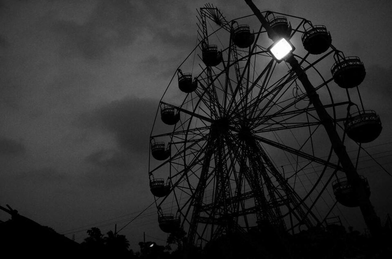 arts culture and entertainment, amusement park, low angle view, ferris wheel, sky, amusement park ride, silhouette, leisure activity, outdoors, night, illuminated, no people
