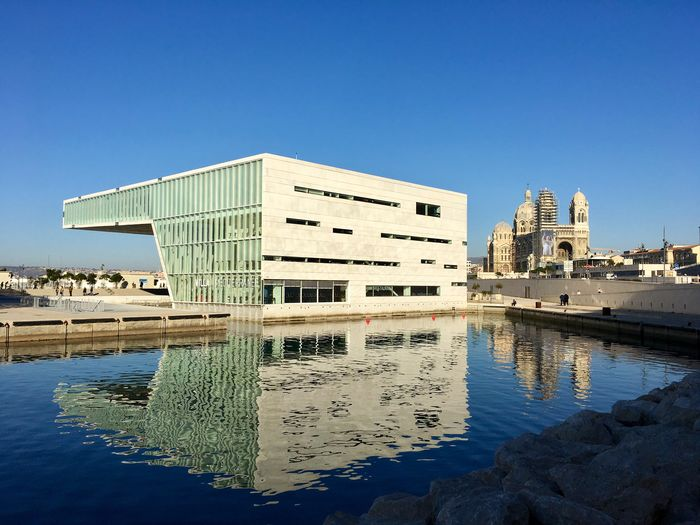 Water Architecture Building Exterior Built Structure Blue Reflection Clear Sky Waterfront Outdoors Day No People Nature Sky Marseille France Frainf Miles Away Miles Away The City Light