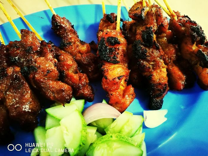 Satay or sate is a Malaysian famous food instead of Nasi Lemak. Served with peanut gravy, onion and cucumber. It's so delicious! Malaysian Food Satay Grilled Meat