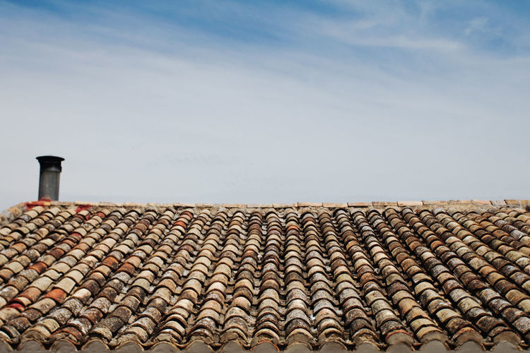 Abundance Blue Sky Cloud - Sky Day In A Row Large Group Of Objects No People Outdoors Red Repetition Roof Roof Tile Rooftop Sky Surface Level