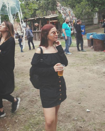 Drinking Weekend Activities Outdoors Standing Lifestyles Women Adult Enjoyment Togetherness Leisure Activity Fun Real People Day Adults Only Young Women People Men Smiling Motion Large Group Of People