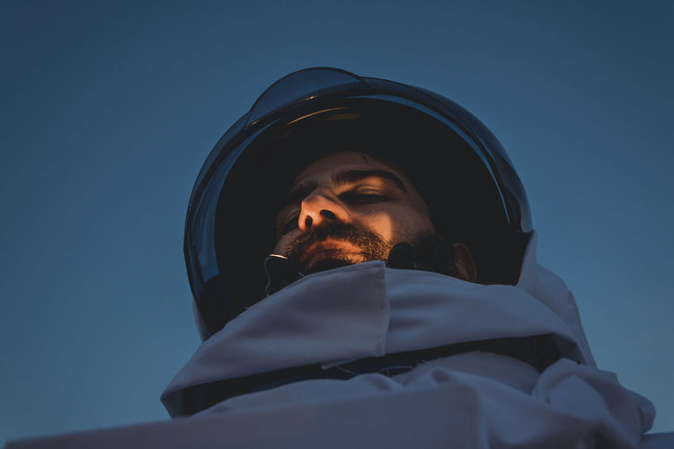 Astronaut standing against clear sky