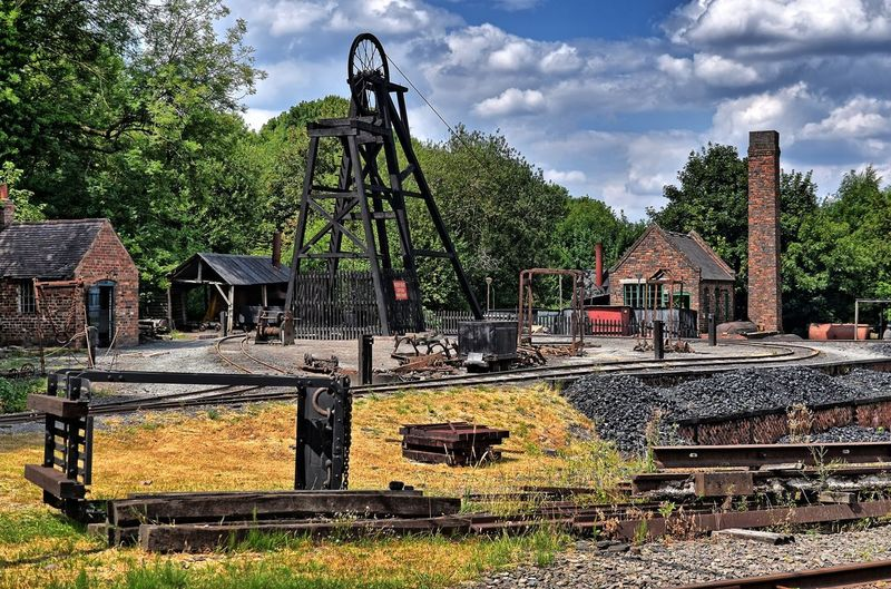 Abandoned railroad tracks against sky