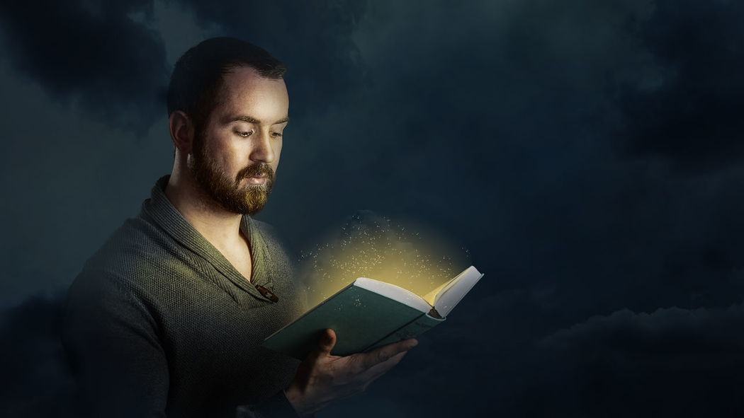 Storyteller Beard Book Books Casual Clothing Fairytale  Glowing Illuminated Knowledge Magic Males  Night Only Men Portrait Reading Real People Story Young Adult