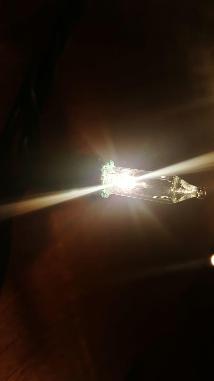 illuminated, lens flare, lighting equipment, electricity, light beam, no people, sun, close-up, outdoors, sky