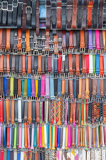 Colorful belts on a street market
