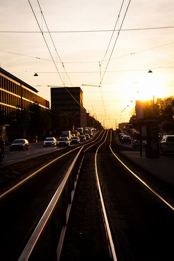 Sunset Transportation Sky Architecture Mode Of Transportation Built Structure Building Exterior City Road Direction Nature No People The Way Forward Railroad Track Cable Rail Transportation Motor Vehicle Car Electricity  Street Track Diminishing Perspective Outdoors Traffic Backlit Sunset