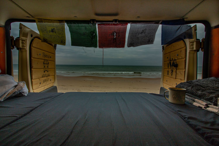 stunning view after an amazing night on the beach in hirtshals, denmark Camping Colourful View Absence Beach Day Flag Horizon Over Water Indoors  Land Mode Of Transportation Nature Nautical Vessel No People Sand Scenics Scenics - Nature Sea Sky Transportation Van Vanlife Vehicle Interior Water Wood - Material