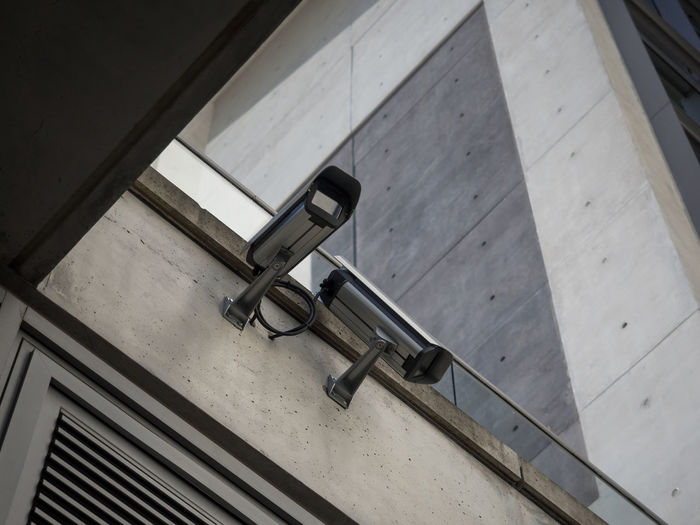 High angle view of security camera on concrete wall