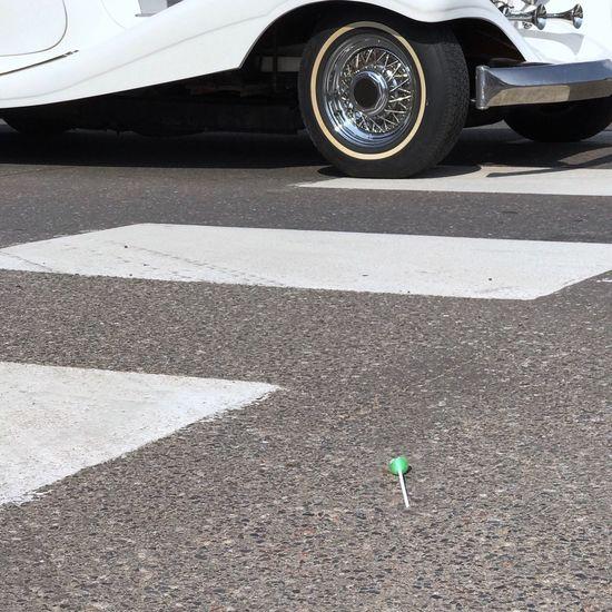 Transportation Road Day No People Mode Of Transport Land Vehicle Minimalobsession Minimal Minimalism Low Angle View Wheel Tire Car Pavement Asphalt Blacktop Gravel White Lollipop Garbage Litter