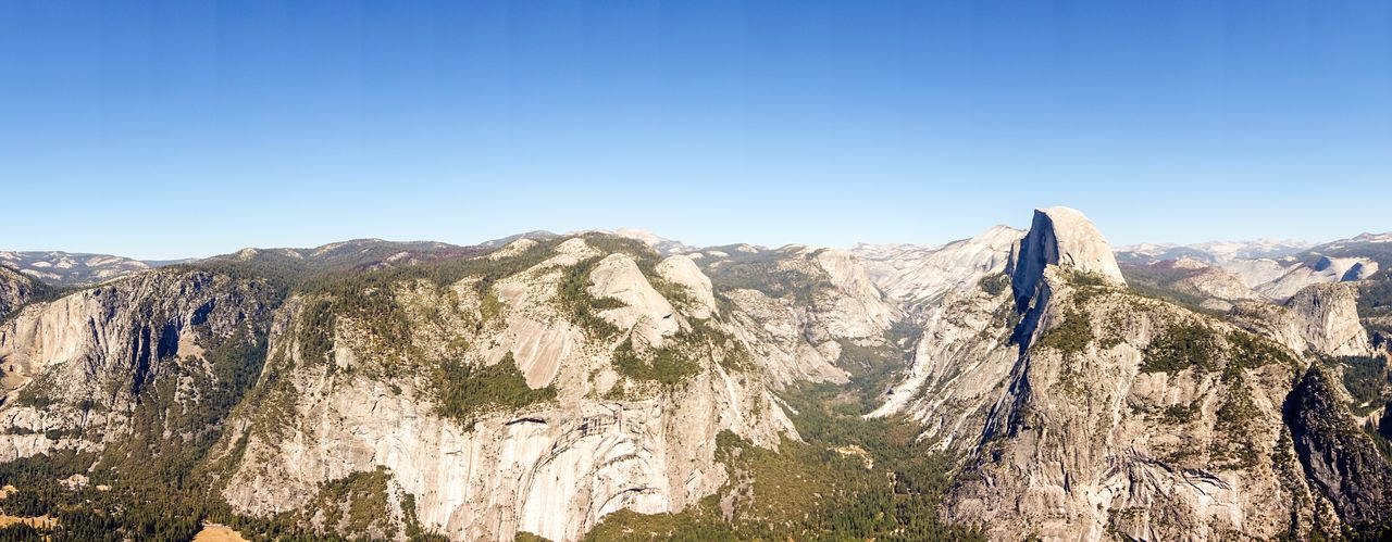 Sky Scenics - Nature Mountain Beauty In Nature Tranquil Scene Clear Sky Tranquility Nature Non-urban Scene Mountain Range Copy Space Environment Landscape Rock Idyllic No People Blue Rock Formation Sunlight Outdoors Formation Mountain Peak Eroded Yosemite National Park Halfdome