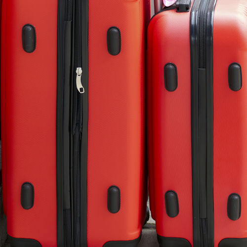 Full frame shot of red suitcases