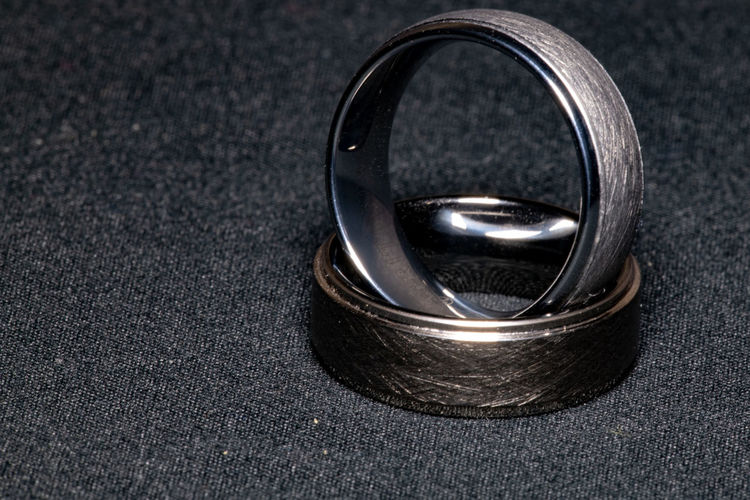 Ring Jewelry Close-up Metal Indoors  Wedding No People Single Object High Angle View Black Color Two Objects Celebration Life Events Wedding Ring Event Focus On Foreground Gray Love Silver Colored Still Life Luxury Platinum Steel