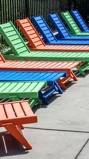 colorful lounging chairs in a row Bradleywarren Photography Room For Text Room For Copy Copy Space Copyspace Backgrounds Background Bradley Olson Colorful Color Colors Chairs In A Row Chair Lounge Chair Deck Chair Sunbathing Vacation South Carolina Tourist Destination Tourism Tourist Tourism Destination Summer Summertime Summer Time  Summer Days Empty Chair Poolside Multi Colored