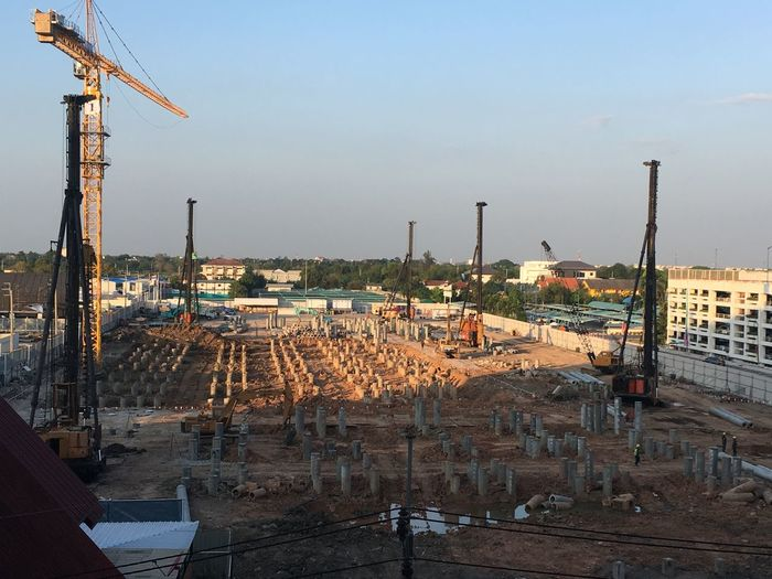 Panoramic view of construction site against buildings in city