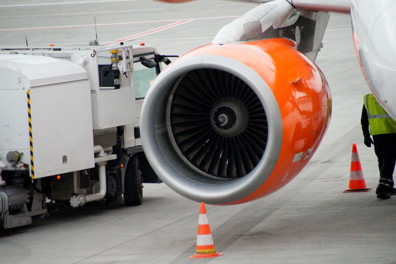 Aerospace Industry Air Vehicle Airplane Airplane Mechanic Airport Airport Runway Art Is Everywhere Break The Mold Close-up Commercial Airplane Day Engine Jet Engine No People Occupation Occupational Safety And Health Outdoors Protective Workwear Reflective Clothing Safety TCPM Traffic Cone Transportation