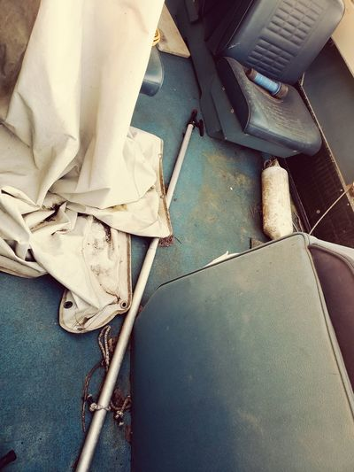 Abandoned boat interior Abandoned Boat Fishing Boat Lazy Days Serene Outdoors Blue And White Canvas Derelict Boat Old Antiqur Vintage EyeEm Selects High Angle View Close-up Fabric Low Section Cloth Cleaning Equipment Canvas Shoe Cleaner