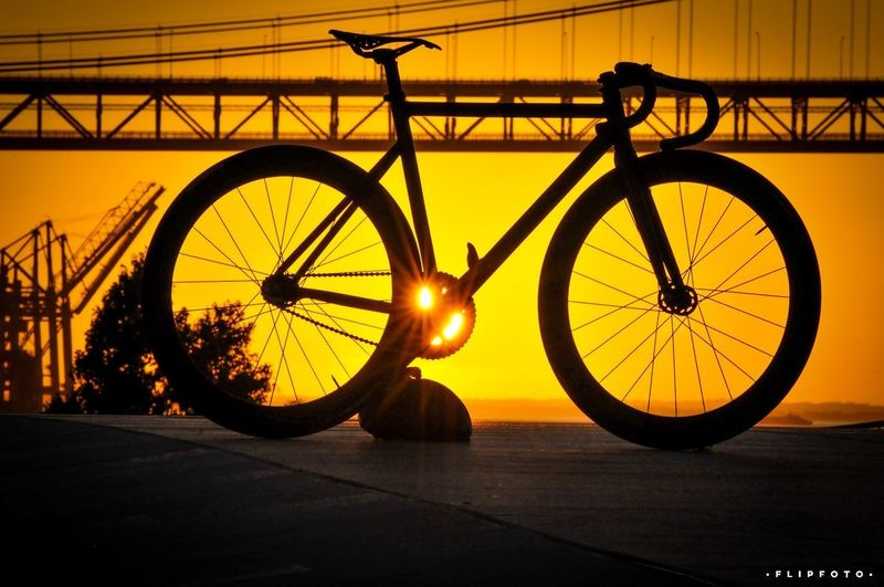 Bicycle Cycling Mode Of Transport Transportation Wheel Sunset Spoke Pedal Silhouette Land Vehicle Back Lit Mountain Bike Stationary Sunlight Racing Bicycle Tire Gear Outdoors No People Bicycle Rack