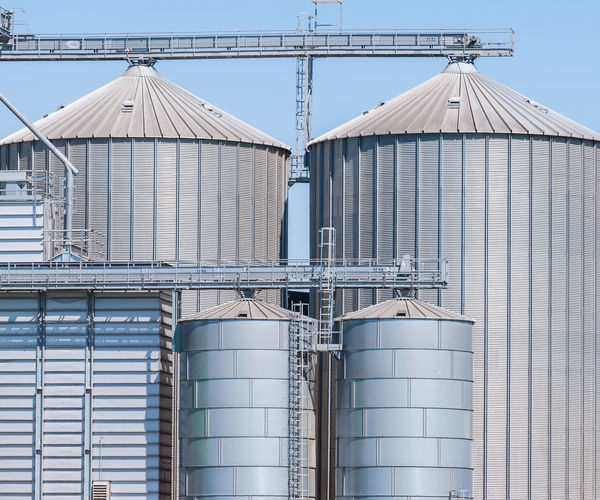 Storage facility cereals and production of biogas; silos and drying towers Agricultural Blue Building Exterior Cereals Day Development Exterior Industrial Industry Iron - Metal No People Outdoors Silos Sky Storage Tank Warehouse