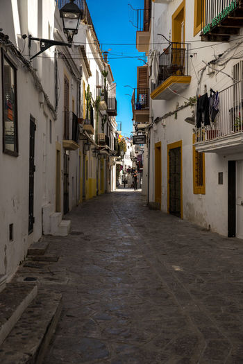 Ibiza Dalt Vila Spaın Baleares Balearic Islands Alley Architecture Building Building Exterior Built Structure City Day Direction Empty Footpath House Long Narrow Nature No People Outdoors Residential District Street The Way Forward Town Transportation Window Summer In The City EyeEmNewHere Old Town