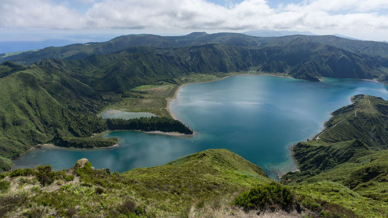Lagoa do Fogo, Azores, Portugal. Azores Lagoa Do Fogo Portugal Sao Miguel- Azores Beauty In Nature Cloud - Sky Day Green Color Idyllic Lake Landscape Mountain Mountain Range Nature No People Non-urban Scene Outdoors Physical Geography Remote Scenics Sky Tranquil Scene Tranquility Tree Water Waterfront