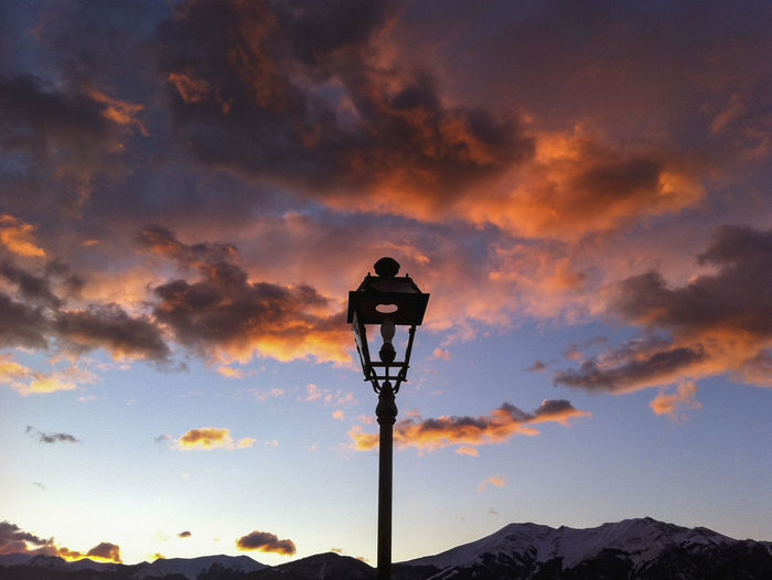 Low angle view of street light against sky during sunset