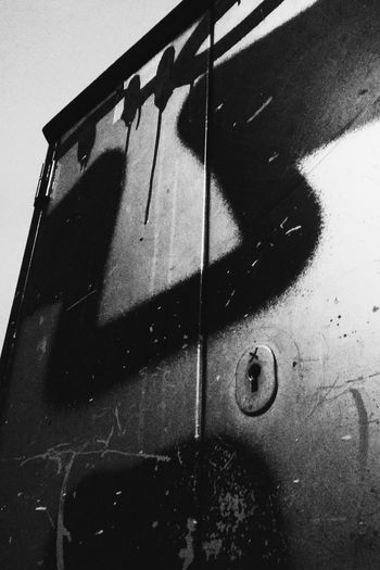 Ghosts with faces 1: Totem. Ghosts With Faces no people Low Angle View Berlin Photography Urbanexploration Urbanexplorer Street Photography Minimalobsession Minimal_perfection Ghostswithfaces Black & White Graffiti Graffiti Blackbook Streetphoto_bw Ghost Faces In Places Face Abstract Spray Bnw