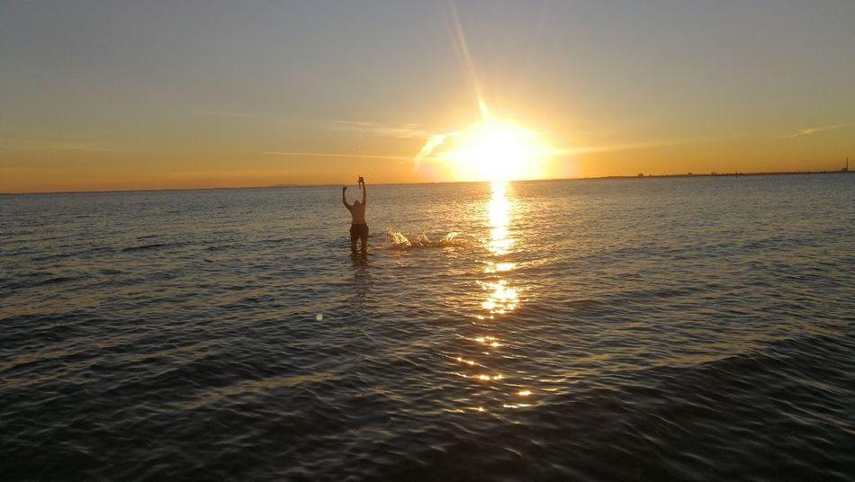 beautiful beach sunset People Melbourne Water Sea Paddleboarding Sunset Summer Beach Sunlight Silhouette Sun Horizon Romantic Sky Dramatic Sky Seascape Tide Coast Low Tide Surf Wave Atmospheric Mood Moody Sky Surfing Surfer Storm Cloud Windsurfing Water Sport Kiteboarding Surfboard Jet Boat