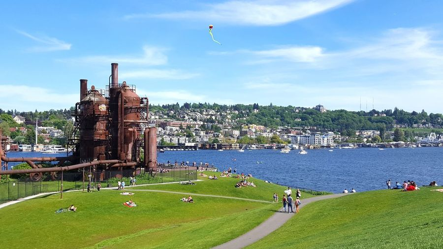 Summer Park Lake Blue Green Kite Outdoors City People Built Structure Seattle Cityscape Grass Sunny Water Relaxing City Park Summer Day Walking Path Grassy Hill Industrial Plant Gasification Coal Plant