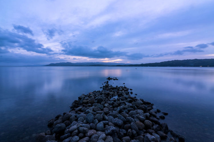 it leads to nowhere... Landscape Seascape Blue Pile Of Stones Late Afternoon Sea Sea And Sky EyeEm Nature Lover Eyeem Market Eyeem Philippines Eyeem Leyte Leading Lines Leading From My Point Of View Rural