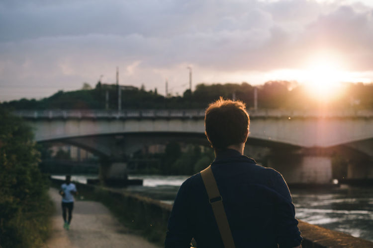 Walking by the Rhône river. Beauty In Nature Casual Clothing City Cloud Cloud - Sky EyeEm EyeEm Best Shots EyeEm Gallery EyeEmBestPics Leisure Activity Lifestyles Nature Outdoors Rear View River Sky Spring Springtime Sun Sunset Walking Around Water