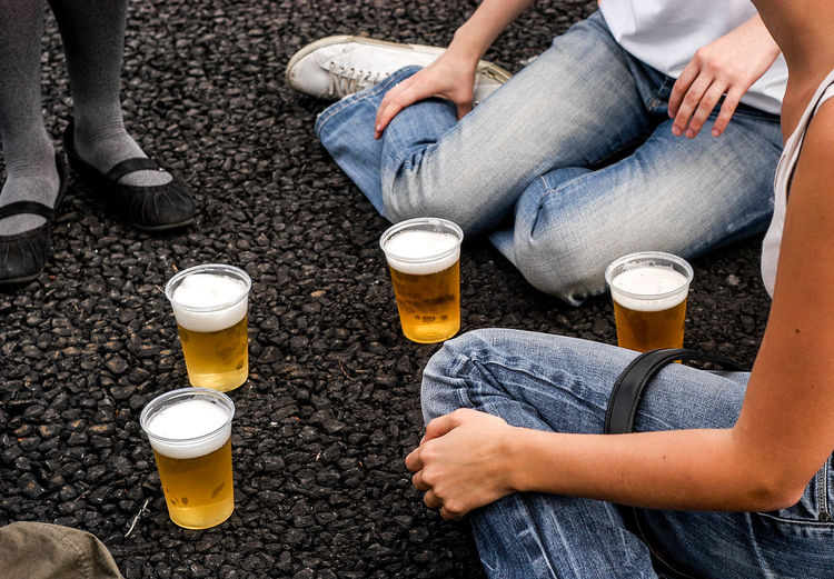 High angle view of friends with beer glasses