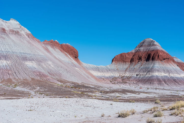 Landscape of barren striped hills or badlands at petrified forest national park in arizona