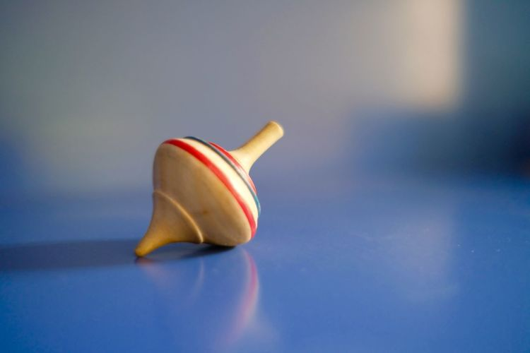 Close-up of colorful wooden spinning top on table
