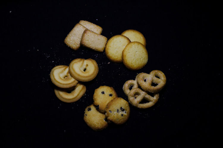 High angle view of cookies against black background