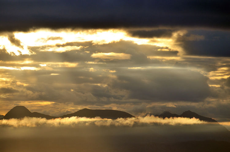 The Highland mountains of the west coast of Scotland at dawn - seen from Culnacnoc on the Isle of Skye Beauty In Nature Cloud Cloud - Sky Cloudscape Cloudy Dawn Dramatic Sky Highland Landscape Majestic Morning Mountain Mountain Range Nature No People Non-urban Scene Remote Scenics Scotland Sky Sunbeam Sunrise