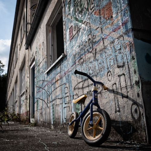 Bicycle parked on old building